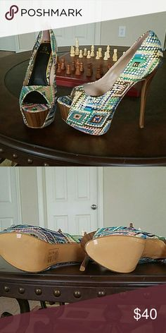 Multi colored Aztec print peep toe pump Super cute and sexy peep toe pump, Brand new in the box!!! Shoes Heels
