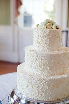25 Classic Wedding Cakes That Stand the Test of Time: An easy recipe for an elegant cake that's hard to forget? A floral and lace-like pattern that's topped off with white roses. Photo by Corbin Gurkin Photography via Style Me Pretty