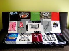 T-Shirt Quilt...I'm gonna get around to making Emilee's one day. Had promised it for grad & then wedding. Maybe for Christmas say 10 yrs from now