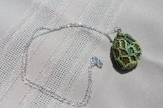 Gorgeous green on green crochet pendant by FuchsiaFoxStudio on Etsy