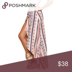 Ethnic print maxi skirt wraparound beach cover up Ethnic print maxi skirt wraparound beach cover up. Length: 40 inches in the longer back side, Can be use as a halter dress too 100% polyester, see thru fabric. Boutique Swim Coverups