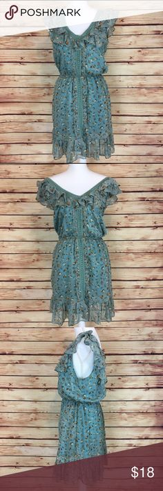 Angie Boho Floral Ruffle Blue Sleeveless Dress Blue floral boho dress by Angie. Ruffle detailing around neck and hem. Crochet detail around the neck line and down the front center. Can be worn off the shoulder or as a v neck. Size medium. Only flaw is a stain on the lining, as pictured, which is not visible when worn. Good preowned condition. Angie Dresses