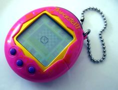 Tamagotchi! I had a dinosaur for some reason. They were banned from our primary school cos we were too obsessed. I made mum look after him at home..