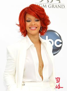 Rihanna Bob     Rihanna switched her look up again at the Billboard Music Awards with a layered bob and side swept bangs.