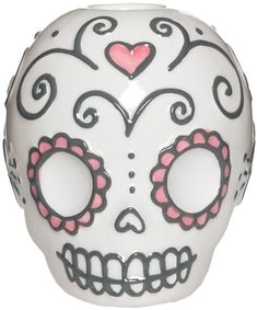 SUGAR SKULL CANDLE HOLDER Decorate your dining room, end table or anywhere you want to add a little glowing ambiance. This darling ceramic sugar skull candle holder holds one taper candle. $12.00 #housewares #sugarskull #dayofthedead #candleholder