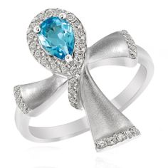 This beautiful ring bears the ancient Egyptian symbol Ankh as its main design. The Ankh is the Egyptian symbol of life and is beautifully used on this ring. At the top is a Pear shaped Blue Topaz with a Ribbon of CZs around it. The band of the ring itself is based on 925 Sterling Silver which is plated with a layer of Rhodium to add a beautiful gleam to it.
