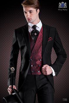 Costume de marié demi-tight noir de coupe élégante Slim. Exclusivité veste de custome en acétate laine noir avec revers en pointe avec bords contrastants en satin noir et un seul bouton, doublure et poche intérieure.