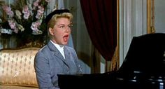 "Jo McKenna (Doris Day): [singing] ""Que Sera, Sera... / Whatever will be, will be / The future's not ours, to see /  Que Sera, Sera / What will be, will be"" -- from The Man Who Knew Too Much (1956) directed by Alfred Hitchcock"