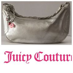 Juicy Couture Metallic Pewter Champagne hobo bag This Hobo Shoulder bag has a braided strap. Top Zipper closure with silver heart, engraved with Juicy Couture and Crown.The other side is adorned with chain and charms. Inside is lined beige fabric. Inside has 1 zipper compartment, other side has cell phone pocket, TINY SCRATCH, only noticeable if you inspect it closely, only used a few times Juicy Couture Bags Hobos
