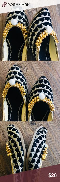 New 2018 ! Black And Silver Jutti New collection 2018 ! Versatile yet subtle styled jutti. Silver color thread work with white Pom Pom and Ghungroos . Complete thread work ! Fine embroidery on the sole to make that statement when you take these off ! Rubber sole. Shoes Flats & Loafers