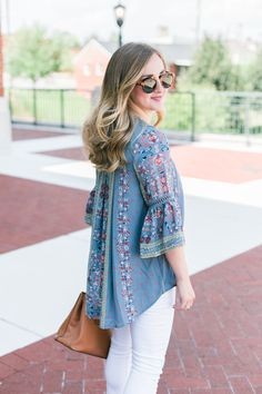 Peasant top with white distressed jeans. Paired with nude braided sandals and a Tory Burch tote
