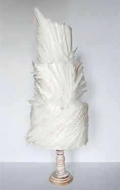 All white feathered textured luxe wedding cake by Lima Cakes on satinice.com!