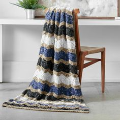 Yarnspirations is the spot to find countless free easy knit patterns, including the Bernat Knit Zig-Zag Blanket. Browse our large free collection of patterns & get crafting today! Diy Throw Blankets, Easy Knit Blanket, Blanket Yarn, Afghan Blanket, Crochet Blanket Patterns, Knitted Blankets, Knitting Patterns Free, Knit Patterns, Free Knitting