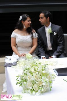 The happy couple with their Flower Power designed bridal bouquet.