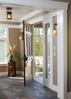 Love the warm slate with the high white baseboards and wooden door. Keep all doors wooden and just paint base boards and trim