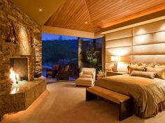 The entire wall is upholstered in this lovely master suite.
