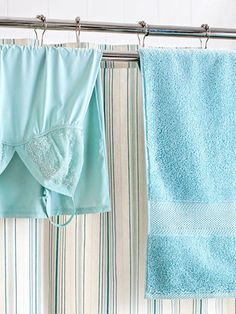 Install a combination shower-curtain rod and towel bar to gain an extra drying rack that won't take up extra space. This one is $42.99 from Stacks and Stacks.