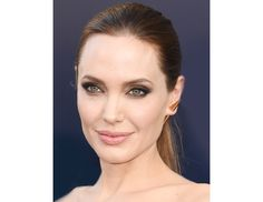 @Byrdie Beauty - Angelina Jolie    Angie can do no wrong—her sleek pony and smoky eye at the Maleficent premiere is classic and flawless (click here for our interview with the movie's makeup artist and prosthetics man!).
