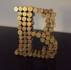 Shot gun shell art.  A neat idea, similar to what is frequently done with corks. Get your shells today for your own DIY project.