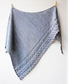 Beautiful cables and lace create an elegant border on this warm & cosy triangular shawl. Worked sideways in a mix of garter stitch, cables and lace in worsted weight yarn makes it a quick and engaging knit. You'll love wrapping yourself up in this warm and eye-catching shawl!