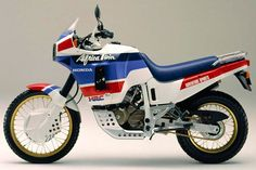Dedicated to the Honda Africa Twin and Packed with useful information. Model types, Buyers guides, Modifications and more. Honda Africa Twin, Cafe Racing, Honda Bikes, Turin, Cars And Motorcycles, Offroad, Japan, Vehicles, Tanks
