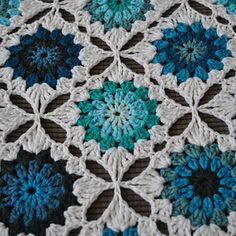 Giving traditional granny squares a modern twist, this pattern is heavy on contrast and color fun.