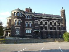 Old Newark Jail House. Mostly stands empty now except for holding records stacked up in the old cells. The castle-like building has four turrents and a lot of decorative stone work including a stone frog attached above one of the side doors. Newark, Ohio.