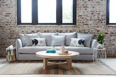 The Lisa Fabric Sofa, Global Round Wooden Coffee Table, Xaria American Oak Side Table with Steel Frame, Armadillo and Co Rug
