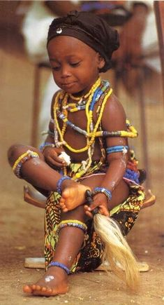 A young #Krobo child from #Ghana. I actually attended a traditional ceremony in Krobo