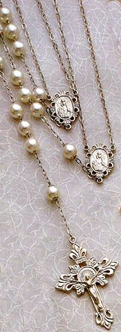Silver Tint Wedding Rosary. 10mm Pearl Bead with Deluxe Crucifix. Share your rosary on this special sacrament. Two rosaries joined together as one. A unique expression of the union of your marriage.