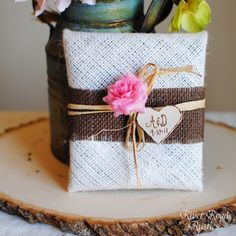 How cute is this??  River Road Rustics designed these cute cd/dvd holders out of... burlap.  (and a few other things.)