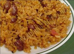 Puerto Rican Rice and Beans This is a traditional dish all Puerto Ricans could relate to, it's very good and flavorful and could be eaten with pork chops or fried chicken or any other meat. Puerto Rican Dishes, Puerto Rican Cuisine, Rice And Beans Recipe Puerto Rican, Authentic Puerto Rican Rice Recipe, Rice And Pink Beans Recipe, Yellow Rice Recipes, Recetas Puertorriqueñas, Comida Boricua, Puerto Rico Food