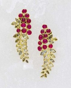 A Pair of Diamond Ruby and Gold LapelClips SUZANNE BELPERRON circa 1940 Designed as a foxglove flower, decorated withmarquise-cut fancy Coloured Diamond s and cabochon rubies,mounted in 18K yellow Gold . with jeweler'smarks forGoene & Darde. with French assaymarks