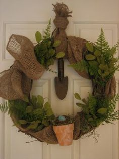 making this from left over burlap, old tools & pruned branches-it will hang outside on garage entry door--best of all it will be free