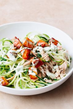 """We're going trendy with this salad and embracing playful spiralized zucchini noodles aka """"zoodles"""" and pairing them with poached chicken breast, a creamy blue cheese dressing, and Buffalo-flavored croutons."""