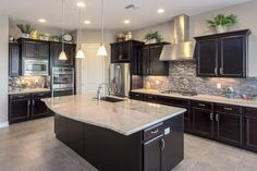 Love this kitchen with dark cabinets & light granite countertops - Before After DIY Light Granite Countertops, Backsplash With Dark Cabinets, Dark Kitchen Cabinets, Kitchen Countertops, Kitchen Backsplash, Granite Kitchen, Backsplash Ideas, Black Cabinets, Island Kitchen