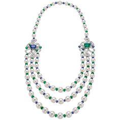 "BVLGARI. FESTA Collection. ""FIOCCO REALE"" Necklace - platinum, 1 cushion Colombia emerald (9,16 carats), 1 cushion Sri Lanka sapphire (14,84 carats), South-Sea cultured pearls, emerald beads (64,63 carats), sapphire beads (56,69 carats) and 4 brilliant-cu"