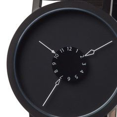 This is one neat watch! Love the reverse concept of the hands pointing IN at the numbers. Nadir Watch - CKIE