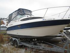 Broker 2007 Bayliner 245SB, 5.0L Mercruiser, 220hp, (no trailer), blue/white,  bimini top, camper canvas, side curtains, aft drop, cockpit table, trim tabs, compass, DF, VHF, GPS, AC/Heat, on-demand water system, dual batteries with switch, stereo/CD, V-berth, aft cabin, sleeps 4, microwave, alcohol/electric stove, refrigerator, enclosed head with pump-out, cabin-like new, fiberglass floor with carpet runners, full swim platform, (4)rod holders, transom shower, bottom paint #16249