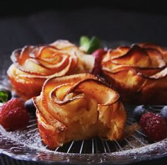 Recipe with video instructions: How to make Apple Rose Tarts with cream cheese.  Ingredients: 1-2 sheets puff pastry, 1/4 cup cream cheese, 3 tbsp sugar, cinnamon, 1 apple, 1 tbsp lemon juice, 3 tbsp water
