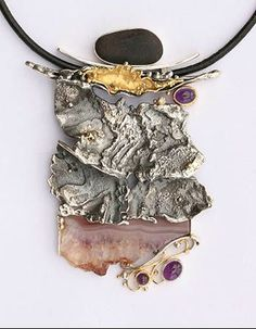 Totem Neckpiece  Sterling silver and 18k yellow gold pendant on leather cord, with amethyst cabochons, banded agate crystal slice, champagne diamond (2.5mm), and beach stone. 10cm x 7cm x 1cm. Stones by Ray Lipovsky.  Exhibit: ROCK ON  Item is available Available ($6880.00)