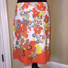 Ixia skirt Ixia skirt with floral pattern in orange, yellow, gray and black with white background. Skirt is fully lined. In excellent condition other than a very small hole at the base of the zipper, it is not even visible when wearing the skirt. I can provide picture upon request. Ixia Skirts A-Line or Full