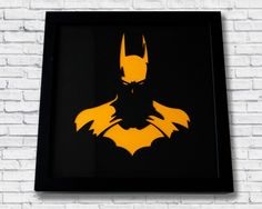 Hand designed and put together this art frame captures an outstanding silhouette image of Batman.This frame is perfect to hang on your wall or can even sit on any flat surface such as a book shelf or mantle.Tech specs:Hand put together art frame, brand new frame made from fibreboard, foil, and glass. With a laser cut mount board design and coloured back.Size |Height – 25cm| Width – 25cm | Depth – 4.5cmCare instructions:Wipe clean with a dry cloth.Disclaimer:Batman is a trademark of the DC…