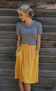 Super cute and modest gathered waist skirt with elastic back waist band and cute front pockets with button details.