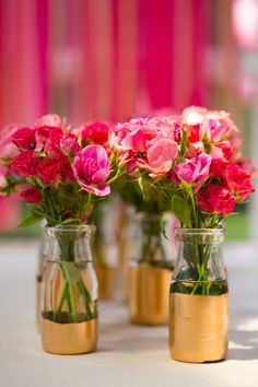 Gold dipped milk bottles as vases - a great center piece idea!