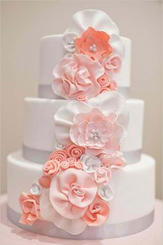 Lovely wedding cake with peach-colored flower icings..