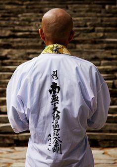 Henro (pilgrim) praying in Shosanji temple, Shikoku, Japan