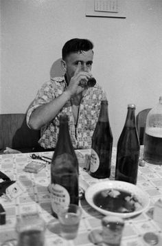 Man drinking a glass of beer, New Zealand, 1960, photograph by Brian Brake.