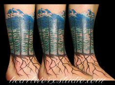 4 trees with mountain background and roots going down foot #tattoo #alberta #rockymountains