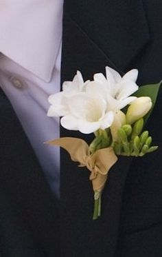 Freesia boutonniere, finished with matte gold ribbon. Do you like the Freesia's for boutonnieres? Prom Flowers, White Wedding Flowers, Floral Wedding, Wedding Bouquets, Ribbon Wedding, Wedding Gold, Freesia Wedding Bouquet, Purple Flowers, Freesia Flowers